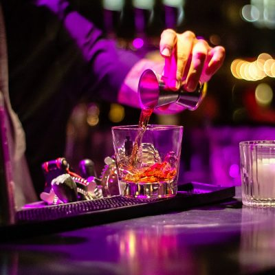 Image of a Bartender Creating a Holiday Cocktail