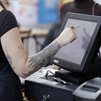 Image of a Bartender Using a POS System