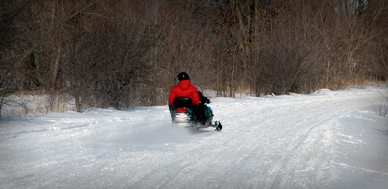 Image of a Person Headed to a Bar on a Snowmobile Trail
