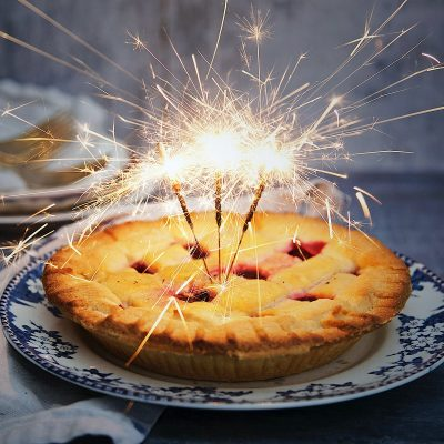 Image of Lit Sparklers in a Christmas Pie