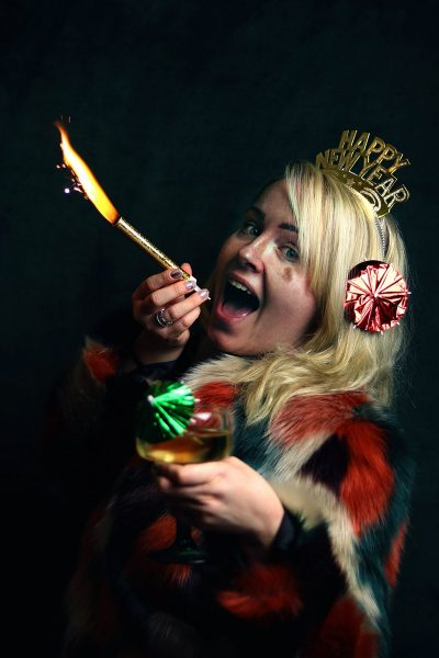 Image of a Woman Using Bottle Sparklers as Photo Props