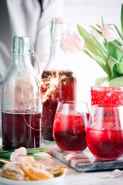 Image of Cocktails with a Lit Sparkler as a Garnish